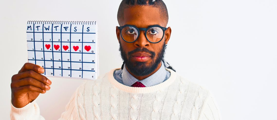 African american man with braids holding period calendar over isolated white background with a confident expression on smart face thinking serious